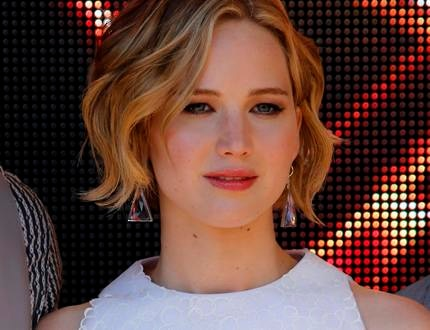"""Cast member Jennifer Lawrence poses during a photocall for the film """"The Hunger Games : Mockingjay - Part 1"""" at the 67th Cannes Film Festival in Cannes"""
