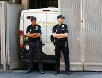 Spanish police stand in front of a van that Naghemeh and Brett, parents of seriously ill Ashya King, arrived in, at the Spanish High Court in Madrid
