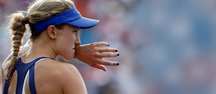 Eugenie Bouchard of Canada reacts after a missed point against Ekaterina Makarova of Russia during their match at the 2014 U.S. Open tennis tournament in New York