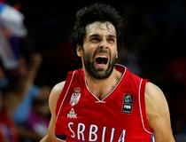 Serbia's Teodosic celebrates after a scoring a three-point shot against France during their Basketball World Cup semi-final game in Madrid