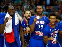 France's players show off their medals as they celebrate their victory over Lithuania at the end of their Basketball World Cup third place game in Madrid