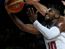 Irving of the U.S. goes up for a basket past Serbia's Krstic and Bircevic during their Basketball World Cup final game in Madrid