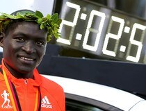 Kimetto of Kenya poses next display with his new world record during the awards ceremony for the 41st Berlin marathon