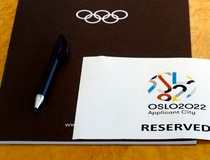 A sign is placed on a table for the Oslo 2022 delegation at the Executive Board meeting in Lausanne
