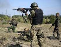 """Ukrainian army soldiers from battalion """"Aydar"""" practise shooting during a military drill in the village of Schastya"""