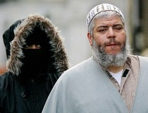 File photo of muslim cleric Sheikh Abu Hamza surrounded by supporters outside the North London Mosque at Finsbury Park