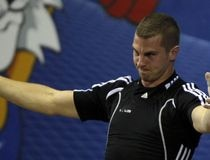 Canada's Marineau gestures after his successful attempt in the men's 85kg weightlifting final at the Commonwealth Games in New Delhi