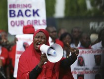 """File photo shows a protester addressing the """"Bring Back Our Girls"""" protest group as they march to the presidential villa to deliver a protest letter to Nigeria's President Goodluck Jonathan in Abuja"""