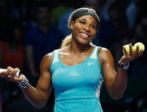 Williams of the U.S. smiles to the crowd after defeating Bouchard of Canada during their WTA Finals singles tennis match at the Singapore Indoor Stadium