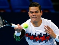 Raonic of Canada returns the ball to Goffin of Belgium during their men's singles match at the Swiss Indoors ATP tennis tournament in Basel