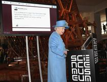 Britain's Queen Elizabeth sends her first Tweet during a visit to the 'Information Age' Exhibition at the Science Museum, in London