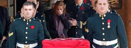 The mother of Cpl. Nathan Cirillo reacts while following pallbearers carrying his casket from a funeral home in Ottawa