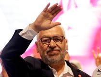 Ghannouchi waves while arriving for campaign event in Tunis