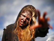 Marie, dressed as a zombie, poses outside the MCM Comicon at the Excel Centre in East London