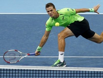 Pospisil of Canada retruns the ball to Dimitrov of Bulgaria at the Swiss Indoors ATP tennis tournament in Basel