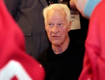 Former Red Wings player Gordie Howe signs autographs for fans in celebration of his 85th birthday before the start of the Red Wing's NHL hockey game against the Blackhawks in Detroit