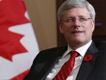 Canada's PM Harper takes part in a photo opportunity in Ottawa