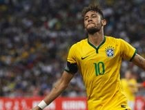 Brazil's Neymar celebrates his fourth goal against Japan during their soccer friendly match at the national stadium in Singapore