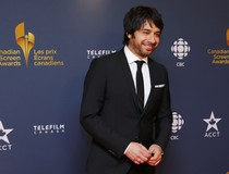 CBC personality Jian Ghomeshi arrives on the red carpet at the 2014 Canadian Screen awards in Toronto