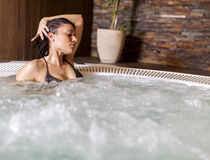 Young woman in hot tub