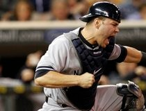 New York Yankees catcher Russell Martin pumps his fist after he tags out Minnesota Twins Ryan Doumit