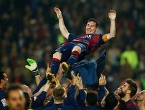 Barcelona's Messi celebrates with teammates at the end of their Spanish first division soccer match against Sevilla at Nou Camp stadium in Barcelona