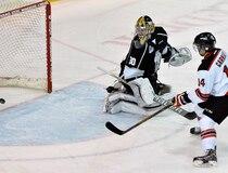 Quebec Ramparts' #14 Olivier Garneau scores on Gatineau Olympiques' goaltender #30 Brandon Whitney