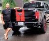 Sylvain Poirier affirme que ses plaques d'immatriculation amusent les gens qui croisent ses deux camions noirs sur la route.