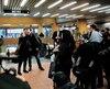 Au lendemain de sa victoire, Justin Trudeau a pris des photos avec des usagers du métro de Montréal.