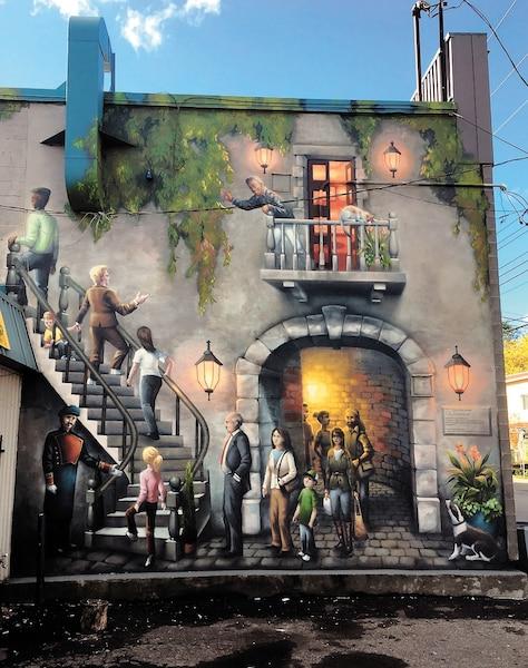 Terrasse Saint-Jacques - 2016</br> Artducommun</br> Comité graffiti Lachine</br> Située 410, rue Saint-Jacques, Lachine</br> Œuvre ludique de type trompe-l'œil, choisie avec les citoyens et partenaires du milieu, pour adoucir la froideur urbaine du quartier.