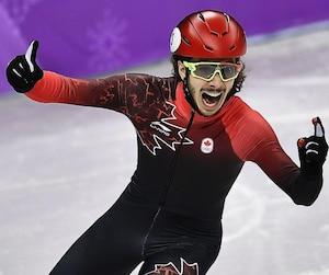 Samuel Girard est devenu le premier Canadien à remporter l'or olympique au 1000m de patinage courte piste.