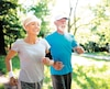 Beautiful sporty mature couple styaing fit with sport