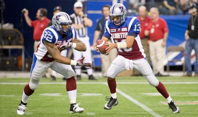 Anthony Calvillo et Chris Jennings lors de la Finale de l' Est entre les Alouettes de Montréal et les Argonauts de Toronto.