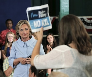 """Demonstrators holding signs reading """"No KXL,"""" referring to the Keystone XL pipeline, interrupt U.S. Democratic presidential candidate Hillary Clinton during a campaign stop in Portland"""