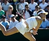 Eugenie Bouchard of Canada hits the ball during her match against Ying-Ying Duan of China at the Wimbledon Tennis Championships in London
