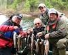 Un trio de pêcheurs qui a démarré sa saison de pêche sur les chapeaux de roues dans le secteur Brown de la réserve faunique du Saint-Maurice. De gauche à droite, Karl Tremblay, René Baillargeon et Gilles Dubois. Debout, à l'arrière, le directeur Francis Desjardins.