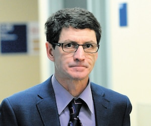 Alain Potvin au moment de l'ouverture de son procès, en novembre 2013, au palais de justice de Québec.