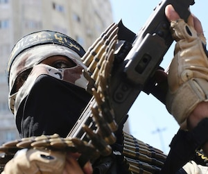 A Palestinian Islamic Jihad militant takes part in a rally celebrating what the militants say was a victory over Israel following a ceasefire in Gaza City