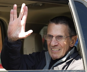 Actor Nimoy gives the 'Vulcan salute' to the crowd while riding in a parade in the town of Vulcan