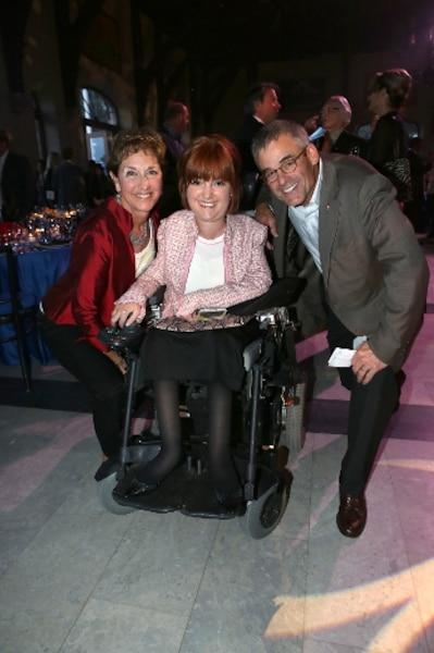 Pierre Boivin, en compagnie d'une enfant handicapée lors de la Soirée-bal.