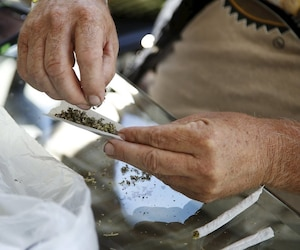 "A marijuana vendor prepares samples for enthusiasts at the ""Weed the People"" event to celebrate the legalization of recreational use of marijuana in Portland, Oregon"