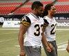Frédéric Plesius (à gauche) a quitté les Tigers-Cats de Hamilton après quatre saisons.