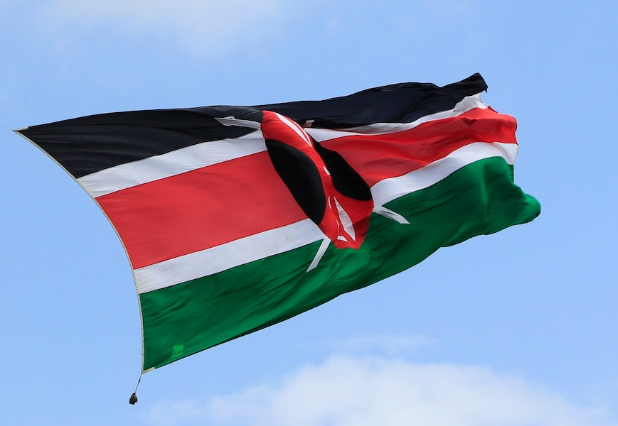 Soldier from the Kenyan green eagles parachutes into Nyayo stadium holding a Kenyan flag during the national celebration to mark Kenya's Jamhuri Day (Independence Day) in capital Nairobi