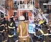L'incendie lié aux accusations portées contre Luc Désy avait lourdement endommagé cet immeuble à logements de troisétages de la rue Sheppard, dans l'arrondissement du Plateau-Mont-Royal, le 30décembre2013.