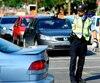 La circulation autour des chantiers est gérée par des policiers syndiqués payés pour des heures supplémentaires, en vertu d'une convention collective que la Ville de Montréal veut rouvrir.
