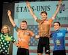 L'Américain Riley Sheehan (3<sup>e</sup> à partir de la gauche) poursuit son règne de champion du Tour de l'Abitibi. Il a été accompagné sur la tribune d'honneur des Canadiens Conor Martin (maillot à pois du meilleur grimpeur) et Riley Pickrell (maillot orange du meneur aux points) et de son coéquipierMichael Garrison (maillot bleu du meilleur 17 ans).