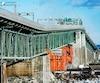 Des barrières automatisées ont récemment été mises en place pour mieux gérer et sécuriser la circulation sur la voie centrale du pont Jacques Cartier. Depuis le 5 mars, un nouveau consortium de firmes de génie est en charge de surveiller les travaux qui seront effectués sur la structure au cours des trois prochaines années.