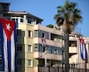 Buildings decorated with Cuban flags are seen near the U.S. embassy (not pictured) in Havana