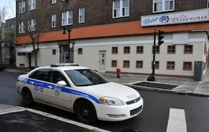Des policiers ont fait des perquisitions vendredi chez deux des personnes soupçonnées d'avoir paralysé le métro de Montréal à l'aide de bombes fumigènes.