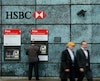 People walk past a HSBC bank branch in the City of London